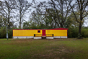 Empty yellow house by Highway on 5th March 2020 in Cottonwood, Alabama, United States of America.