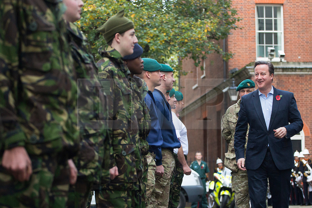 © licensed to London News Pictures. London, UK 09/11/2013. The Royal Marines and Commando 999 meeting with Prime Minister David Cameron on Downing Street on Saturday, November 9, 2013 after Commando 999's attempt to break the Speed March World Record by completing the 26.2 mile London marathon course in less than 4 hours and 19 minutes. Photo credit: Tolga Akmen/LNP