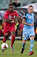 SYDNEY, NSW- NOVEMBER 21: Sydney FC defender Luke Wilkshire (26) and Adelaide United defender Mark Ochieng (12) chase the ball at the FFA Cup Final Soccer between Sydney FC and Adelaide United on November 21, 2017 at Allianz Stadium, Sydney. (Photo by Steven Markham/Icon Sportswire)