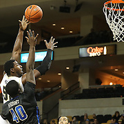 ORLANDO, FL - DECEMBER 31:  Staphon Blair #52 of the UCF Knights sky hooks the ball during an NCAA basketball game against the Tulsa Golden Hurricane at the CFE Arena on December 31, 2014 in Orlando, Florida. (Photo by Alex Menendez/Getty Images) *** Local Caption *** Staphon Blair