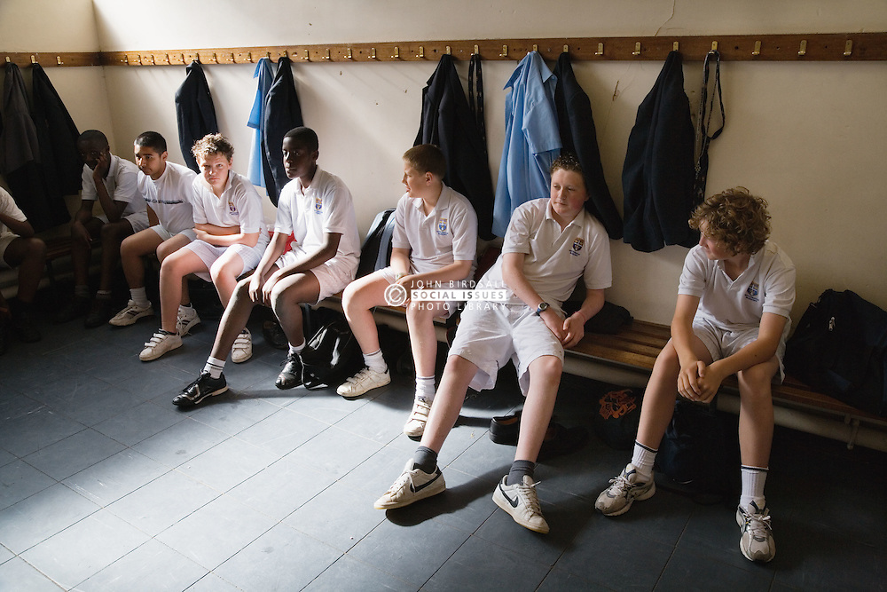 Group of secondary school students sitting in the changing room before a PE class,