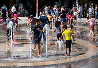Kids keeping cool in the  new coventry precinct fountain on the opening day of the Coventry city of culture 2021