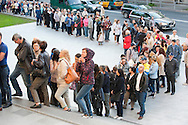 People queue on Museums Night outside the Latvian National Museum of Art, Riga, soon after it reopened following a two year renovation project. Riga, Latvia (May 2016) © Rudolf Abraham