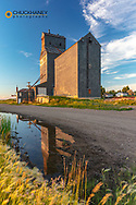 Grain elevator in days last light in Medicine Lake, Montana, USA