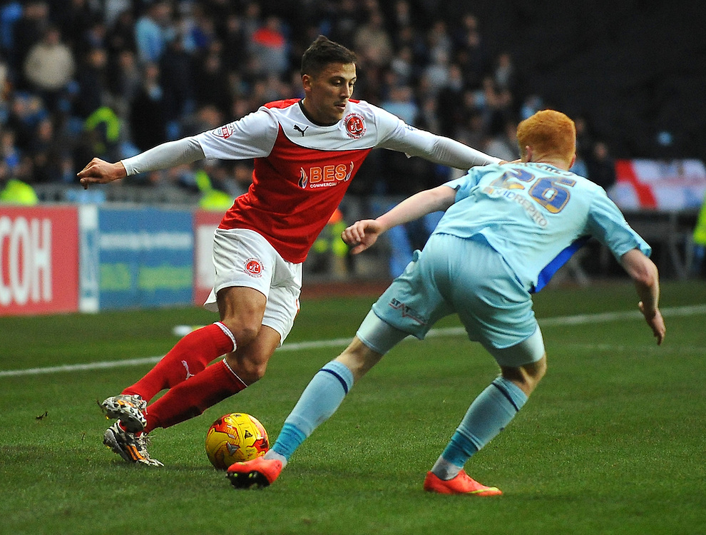 Fleetwood Town's Antoni Sarcevic under pressure from Coventry City's Ryan Haynes<br /> <br /> Photographer Kevin Barnes/CameraSport<br /> <br /> Football - The Football League Sky Bet League One - Coventry City v Fleetwood Town - Saturday 20th December 2014 - The Ricoh Arena - Coventry<br /> <br /> © CameraSport - 43 Linden Ave. Countesthorpe. Leicester. England. LE8 5PG - Tel: +44 (0) 116 277 4147 - admin@camerasport.com - www.camerasport.com
