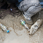 Refugees and migrants  waiting in a muddy field to get registered by the Greek authorities in in Moria camp, Lesvos, Greece.