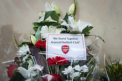 © Licensed to London News Pictures. 20/06/2017. London, UK. Flowers from Arsenal Football Club left beneath a bridge in Finsbury Park, north London, close to the scene of the attack. A man drove a white van into a crowd of Muslims in Finsbury Park after Ramadan prayers early on the morning of Monday 19 June 2017, killing one man and injuring a number of others. Photo credit: Rob Pinney/LNP