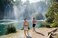 Two young men from the United States and Australia, backpacking in Eastern Europe, enjoy an afternoon at Kravice Falls, located about 40 kilometers from Mostar, in Bosnia and Herzegovina.