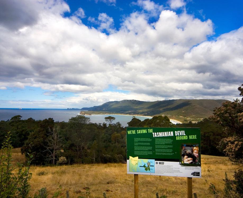 Tasmanian Devils Information Sign, with Pirates Bay behind, Tasman Peninsula