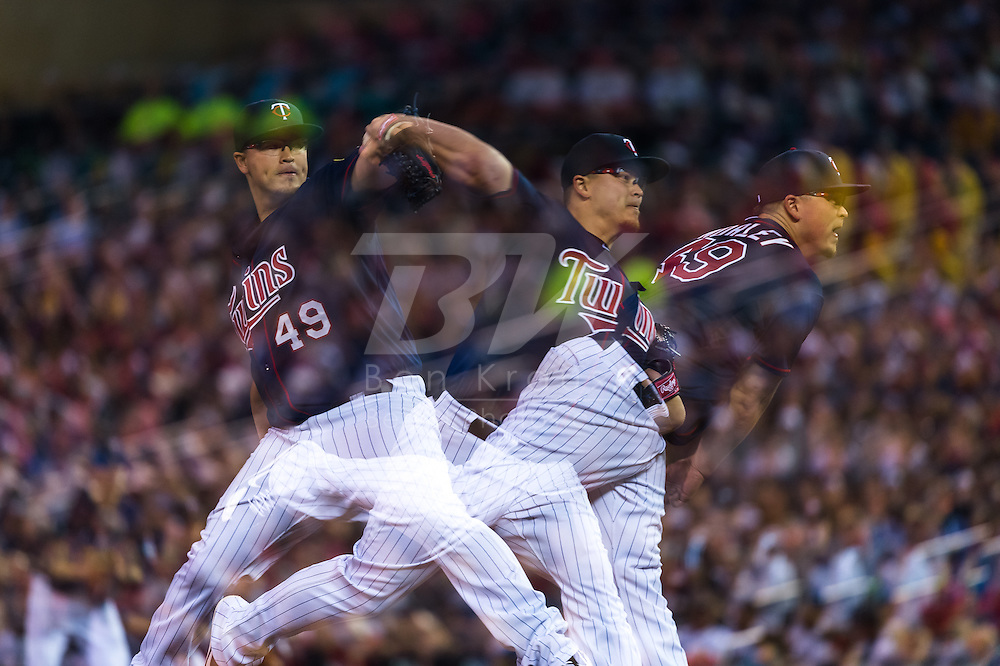[Note: This photo was created by combining multiple exposures in-camera.] Vance Worley #49 of the Minnesota Twins pitches against the Boston Red Sox on May 17, 2013 at Target Field in Minneapolis, Minnesota.  The Red Sox defeated the Twins 3 to 2.  Photo: Ben Krause