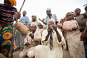 The local community gather for a funeral which lasts three days in the village of Rhumsiki, Cameroon
