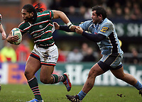Photo: Rich Eaton.<br /> <br /> Leicester Tigers v Cardiff Blues. Heineken Cup. 13/01/2007.Alesana Tuilagi attacks for Leicester Tigers and escapes the tackle of Gary Powell right of Cardiff