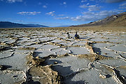 Contemplating life below sea level at Badwater Basin, Death Valley National Park, California.