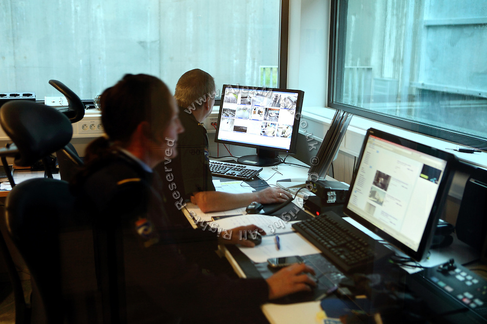 Guards are monitoring the luxurious Halden Fengsel (prison) through a CCTV camera system while sitting near the main entrance in Halden, near Oslo, Norway.