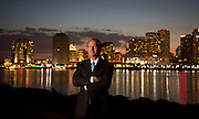 Attorney Carl Rosenblum stands next to the Mississippi River with the New Orleans skyline in the background.