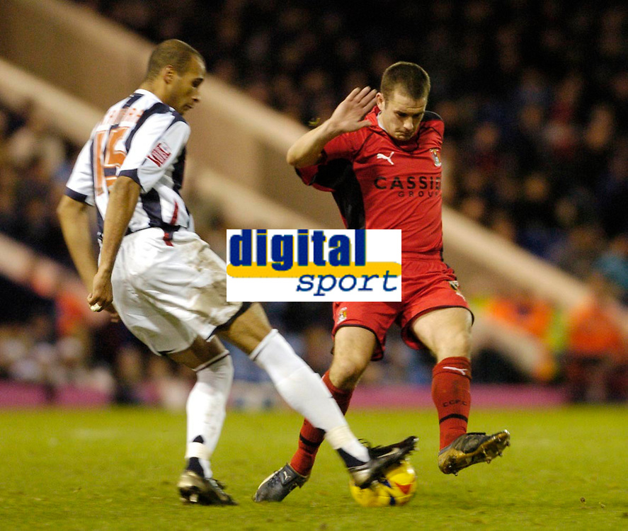 Photo: Leigh Quinnell.<br /> West Bromwich Albion v Coventry City. Coca Cola Championship. 16/12/2006. Coventrys Michael Doyle challenges West Broms Diomansy Kamara.