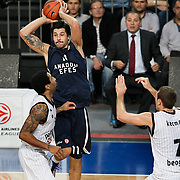 Anadolu Efes's Cenk AKYOL (C) during their Turkish Airlines Euroleague Basketball Group C Game 6 match Anadolu Efes between Partizan at Sinan Erdem Arena in Istanbul, Turkey, Wednesday, November 23, 2011. Photo by TURKPIX