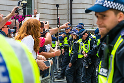 "Far right demonstrators hurl abuse at anti-fascist counter demonstrators as several hundred far right protesters in central London demand the release of ""political prisoner"" right wing talisman Stephen Yaxley-Lennon  - also known as Tommy Robinson, who was imprisoned for contempt of court. London, August 03 2019."