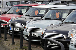 © Licensed to London News Pictures. 17/01/2012. BMW Mini cars on a forecourt in Bromley, Kent, today 17th January 2012.  Mini is recalling 235,000 cars due to an electrical fault which can cause vehicles to burst into flames. Nearly 30,000 cars in the UK are understood to be affected. Photo credit : Grant Falvey/LNP
