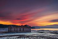 Church ruins by Zhrebchevo lake at dusk