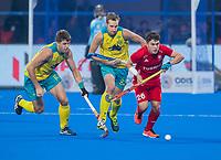 BHUBANESWAR, INDIA - James Gall (Eng) with Eddie Ockenden (Aus)  during England vs Australia ,  the Odisha World Cup Hockey for men  in the Kalinga Stadion.   COPYRIGHT KOEN SUYK