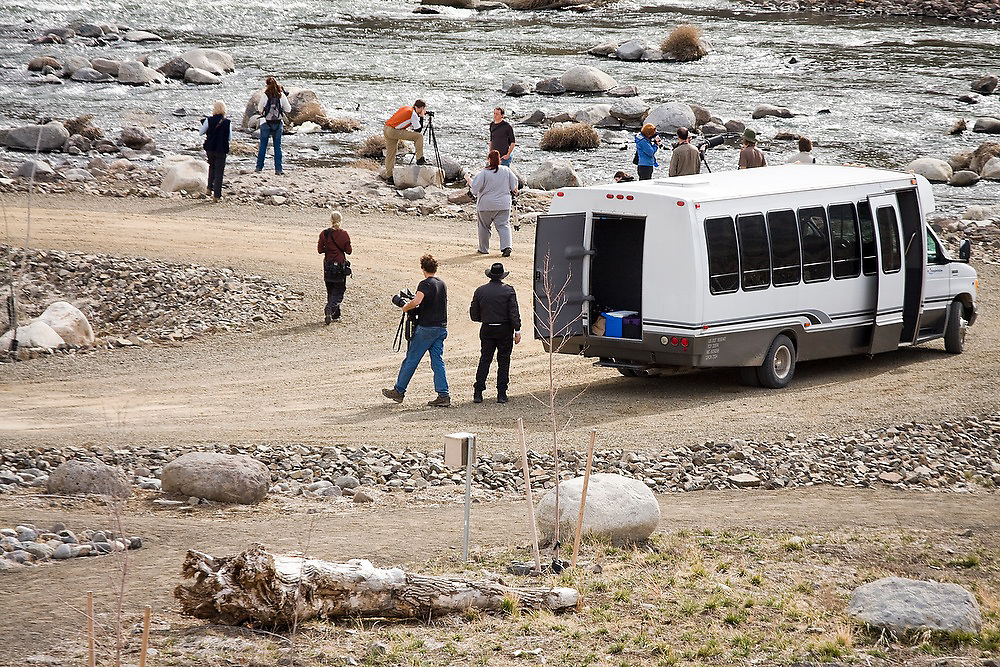 Scholarship students at the North American Nature Photography Association arrive by bus to photograph Lockwood, near Reno, Nevada. The site is one of three properties so far being restored in a $20 million effort by the Nature Conservancy to revitalize the Lower Truckee River ecosystem.