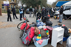 Sipson, UK. 8th March, 2021. Metropolitan Police officers facilitate the eviction of residents from the remaining section of a squatted off-grid eco-community garden known as Grow Heathrow. Grow Heathrow was founded in 2010 on a previously derelict site close to Heathrow airport in protest against government plans for a third runway and has since made a significant educational and spiritual contribution to life in the Heathrow villages which are threatened by airport expansion.
