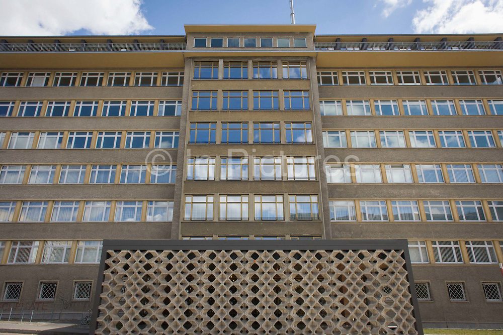 Exterior of 'Haus 1' the ministerial headquarters of the Stasi secret police in Communist East Germany, the GDR. Built in 1960, the complex now known as the Stasi Museum. Before the fall of the Wall, it was a 22-hectare complex of espionage whose centrepiece is the office and working quarters of the former Minister of State Security, Erich Mielke who considered their role as the 'shield and sword of the party', conducting one of the world's most efficient spying operations against its political dissenters during its 40-year old socialist history. Between 1950 and 1989, the Stasi employed a total of 274,000 people in an effort to root out the class enemy.