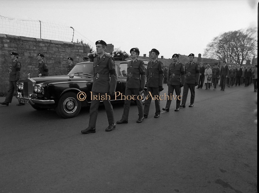 Body of Private Stephen Griffin killed in Lebanon is returned to his home soil..1980-04-19.19th April 1980.19-04-1980.04-19-80..Photographed at Arbor Hill:..Guard of honour from the Ist Field Engineers Company, Cork, colleagues of the late Private Stephen Griffin, acompany the hearse as it arrives at Arbor Hill, Dublin.