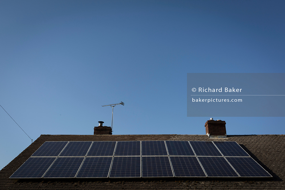 Solar panels on the roof of a rural bungalow, on 5th May 2018, in Wrington, North Somerset, England.