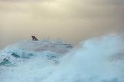 Passenger boat in stormy waves, Norway | Hurtigruten MS Nordkapp passerer Ulsteinvik og Flø i røff sjø.