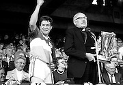 Winners of the All Ireland minor hurling final, Offaly defeated Cork with a score of 3-12 to 3-9. Here the victorious Offaly captain, Michael Hogan, is about to receive the Irish Press Cup from Dr T Morris, Archbishop of Cashel.<br /> 7 September 1986