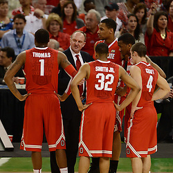 Mar 31, 2012; New Orleans, LA, USA; Ohio State Buckeyes head coach Thad Matta talks to his team during the first half in the semifinals of the 2012 NCAA men's basketball Final Four against the Kansas Jayhawks at the Mercedes-Benz Superdome. Mandatory Credit: Derick E. Hingle-US PRESSWIRE