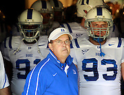 CHARLOTTESVILLE, VA- NOVEMBER 12: Head coach David Cutcliffe of the Duke Blue Devils stands with his players before the game against the Virginia Cavaliers on November 12, 2011 at Scott Stadium in Charlottesville, Virginia. Virginia defeated Duke 31-21. (Photo by Andrew Shurtleff/Getty Images) *** Local Caption *** David Cutcliffe