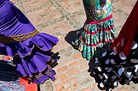 Ladies swirl in colorful Spanish dresses near the Mezquita (Mosque-Cathedral) in Cordoba, Spain.