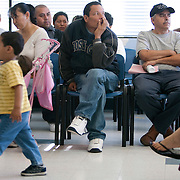 The crowded waiting room at the South Central Family Health Center in Los Angeles, CA as patients wait for medical care. Please Contact Me With Licensing Questions or Requests. Please contact Todd Bigelow directly with your licensing requests. This image is *not* available for licensing via online. Please contact Todd Bigelow directly with your licensing requests. This image is *not* available for commercial use.