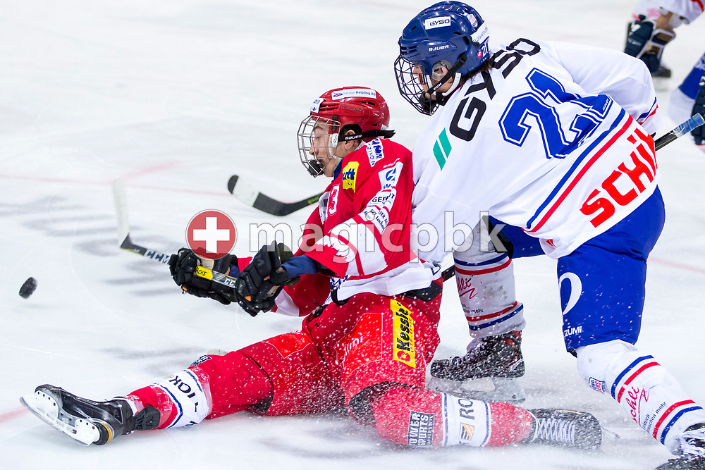Rapperswil-Jona Lakers forward Jonas Graetzer (L) is being checked by EHC Buelach forward Nicolas Bardh during the first Elite B 1/4 final Playoff ice hockey game between Rapperswil-Jona Lakers and EHC Buelach in Rapperswil, Switzerland, Tuesday, Feb. 13, 2018. (Photo by Patrick B. Kraemer / MAGICPBK)