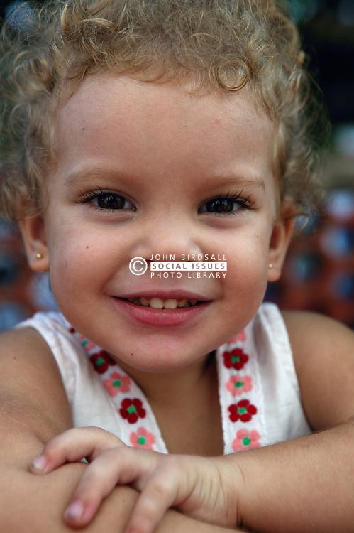 Portrait of white child in Havana nursery school,