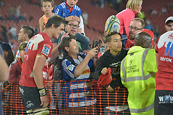 070418 Emirates Airlines Park, Ellis Park, Johannesburg, South Africa. Super Rugby. Lions vs Stormers. Lions captain Franco Mostert takes a selfie with a fan during a meet and greet after the game before embarking on the Lions away tour.<br /><br />Picture: Karen Sandison/African News Agency (ANA)