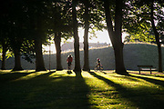 The sun is low over Landskronas citadel and a mother and daughter ride their bikes in the sun, Sweden, 27th of August 2016.