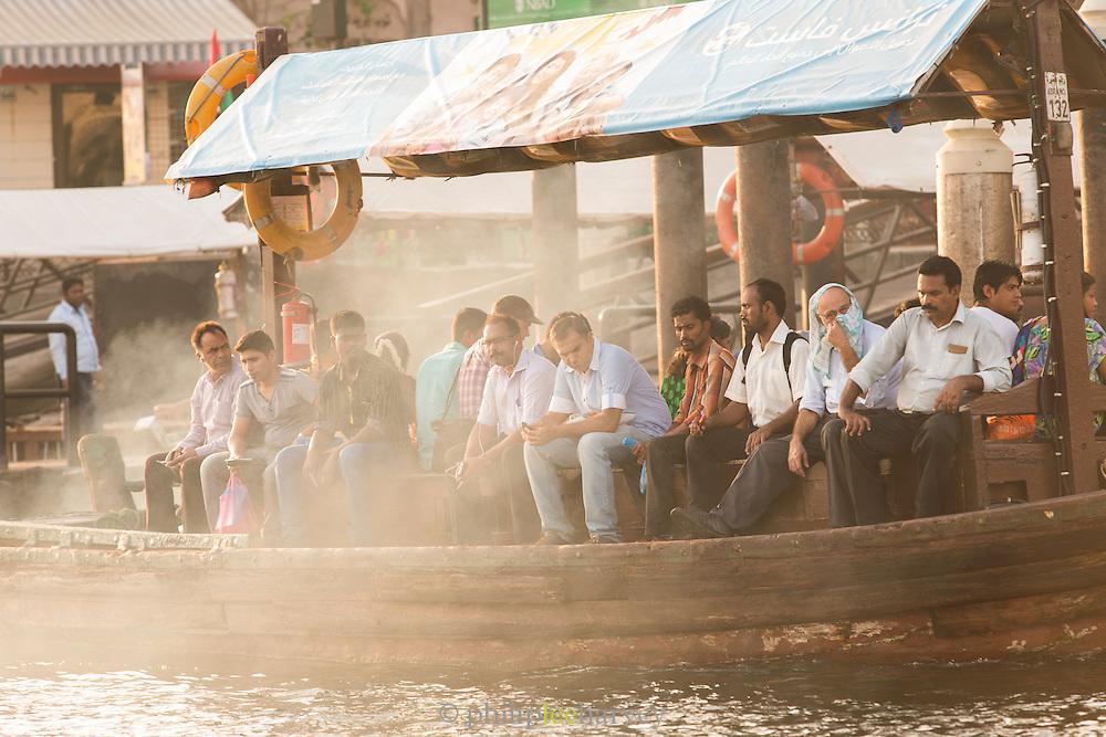 Passengers waiting for water bus, Dubai Creek, Deira area, United Arab Emirates