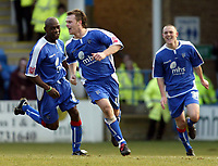 Photo: Chris Ratcliffe.<br />Gillingham v Bristol City. Coca Cola League 1. 26/12/2005.<br />Michael Flynn of Gillingham celebrates his equaliser with Ian Cox (L) and Andrew Crofts (R).