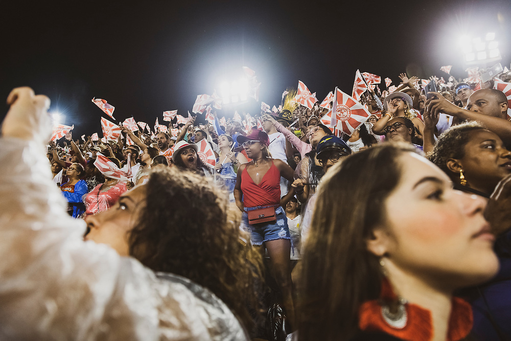 Rio de Janeiro, Brazil - March 4, 2019 - Spectators in a grandstand watch the Rio Carnival Sambadrome Parade at two o'clock in the morning. It will end around sunrise.