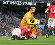 Manchester City's Joe Hart tussles with Manchester United's Wayne Rooney<br /> <br /> - Barclays Premier League - Manchester City vs Manchester Utd - Etihad Stadium - Manchester - England - 2nd November 2014  - Picture David Klein/Sportimage