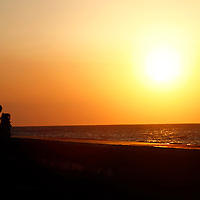 Central America, Cuba, Havana. Sunset silhouettes on the Malecon.