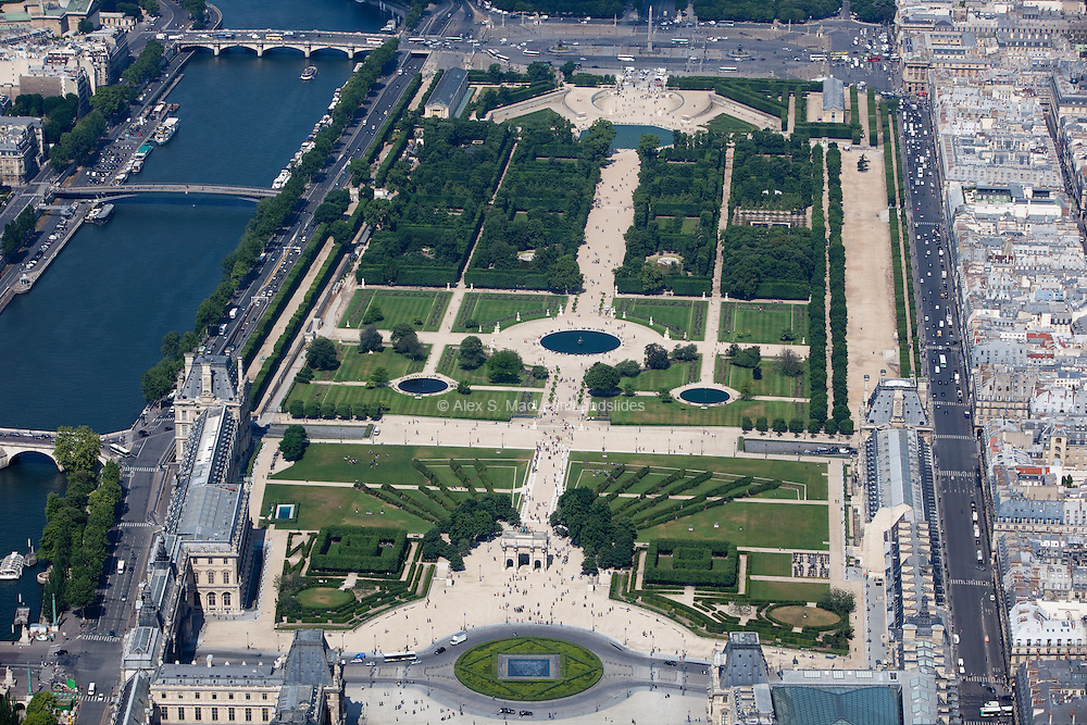 Looking above the Louvre Museum down the Jardin de Tuileries (a public garden located between the Louvre Museum and the Place de la Concorde. It was created by Catherine de Medicis as the garden of the Tuileries Palace in 1564, and was eventually opened to the public in 1667, and became a public park after the French Revolution.)