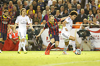 Real Madrid´s Pepe (R) and F.C. Barcelona´s Andres Iniesta during the Spanish Copa del Rey `King´s Cup´ final soccer match between Real Madrid and F.C. Barcelona at Mestalla stadium, in Valencia, Spain. April 16, 2014. (ALTERPHOTOS/Victor Blanco)