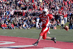 14 October 2006: Rafael Rice breaks the plane of the end zone. The 6th largest crowd at Hancock Stadium came to watch a game that put 8th ranked Southern Illinois Salukis against 5th ranked Illinois State University Redbirds.  The Redbirds stole the show for a Homecoming win by a score of 37 - 10. Competition commenced at Hancock Stadium on the campus of Illinois State University in Normal Illinois.<br />