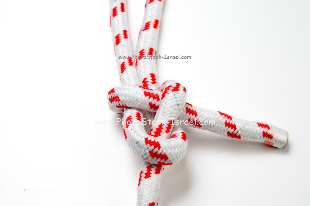 The Sheet Bend knot on white background for joining two ropes of unequal size