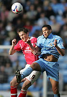 Photo: Lee Earle.<br /> Coventry City v Barnsley. Coca Cola Championship. 17/03/2007.Barnsley's Istvan Ferenczi (L) clashes with Marcus Hall.